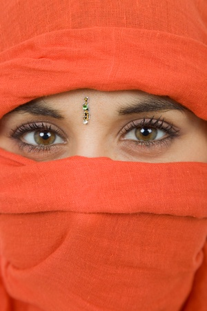 arab glamour: young woman with a veil, close up portrait, studio picture Stock Photo