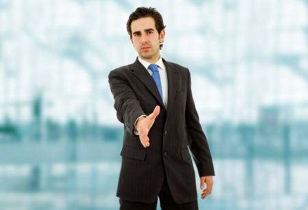 young man in suit offering to shake the hand Stock Photo - 15427044
