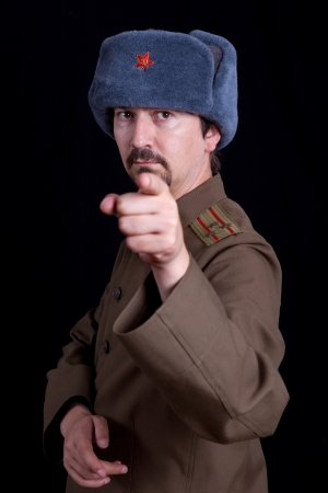 russian hat: young man dressed as russian military, studio