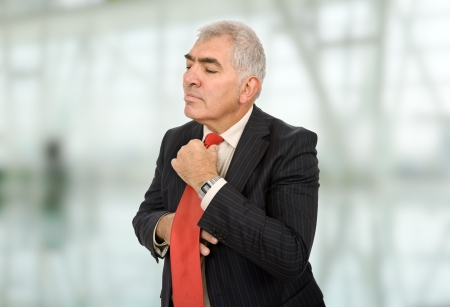 business man adjusting his tie at the office photo