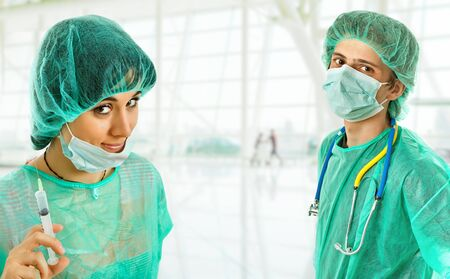 smock: two young doctors, isolated on white background