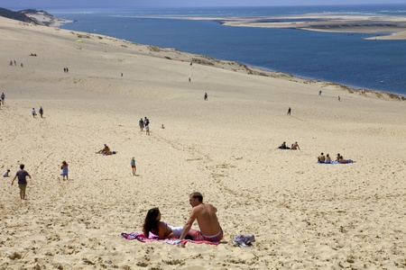 People visiting the Famous dune of Pyla, the highest sand dune in Europe, on August 8, 2012 in Pyla Sur Mer, France. Stock Photo - 15791627