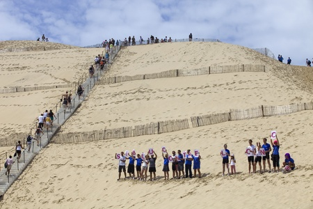 People from Siblu organization in action against cancer in\ the famous dune of Pyla, on August 8, 2012 in Pyla Sur Mer, France.\