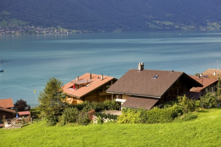 View of wooden cabins with a lake and mountain at switzerland photo