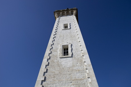 cote de granit rose: Granitic lighthouse in the harbour of Roscoff in Brittany