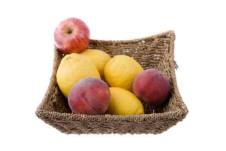 basket of fruits isolated on white photo
