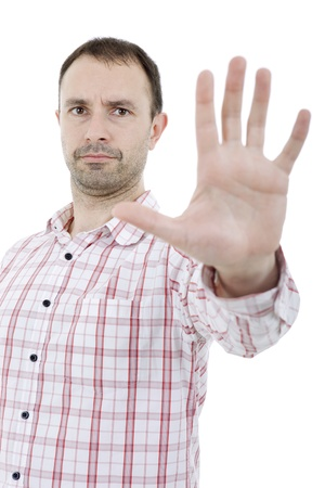 young man making stop with his hand, isolated photo