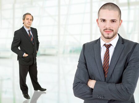 two business men standing at the office photo
