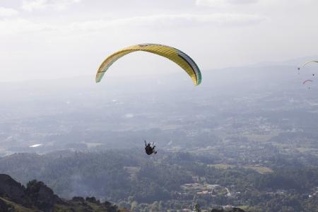 paradglider: CALDELAS, PORTUGAL - OCTOBER 13: Paragliding Aboua Cup, in the north of Portugal, October 13, 2012, Caldelas, Portugal.