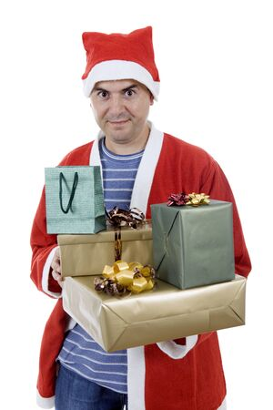 young man with santa hat holding gifts, isolated Stock Photo - 17135481