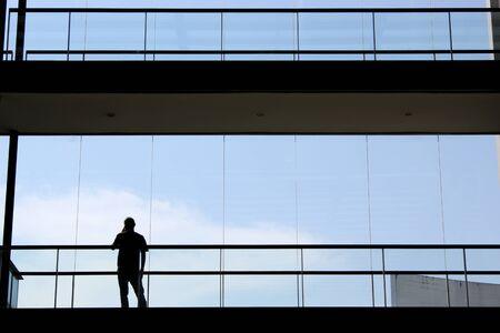 young man inside a modern office building photo