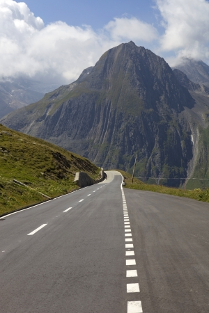 swiss road at the top of the mountains photo