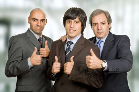 three young business men at the office photo