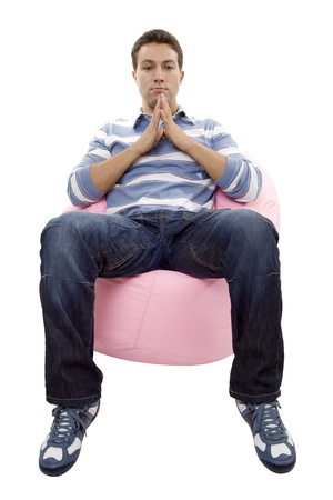 young casual man seated in a small sofa Stock Photo - 17927193
