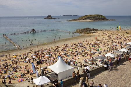 st malo: crowded st malo beach, brittany, france
