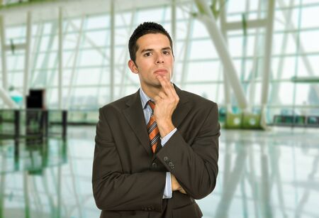 worried executive: young business man thinking, at the office Stock Photo