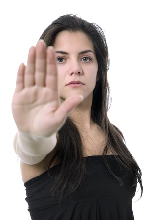 young woman going stop with her hand, isolated photo
