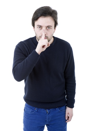 young man showing silence gesture with his finger in the mouth photo