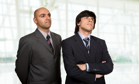 two young business men thinking, at the office photo