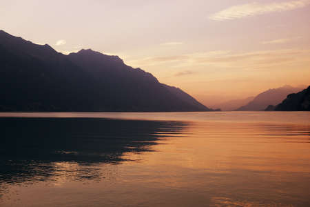 swiss lake at sunset in brienz, Switzerland photo