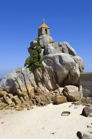 cote de granit rose: Coast of France in Brittany, the famous small chapel at the rocks in Port-Blanc Stock Photo
