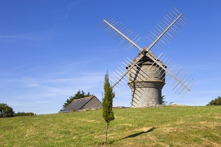typical brittany windmill in the north of france photo