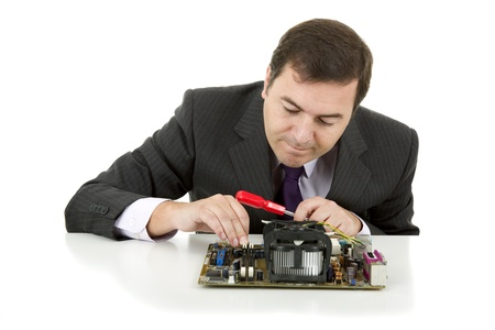 Computer Engineer working in a motherboard, isolated photo