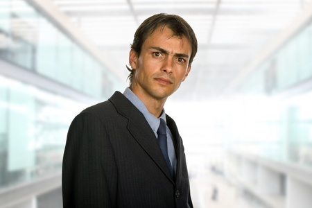 young business man portrait at the office photo