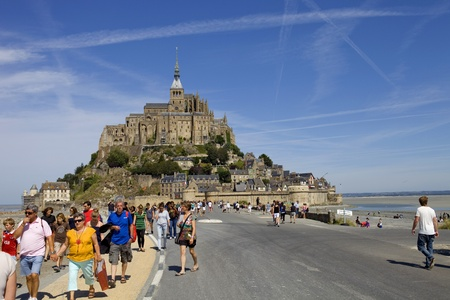 people in the mont saint michel view, in the north of france