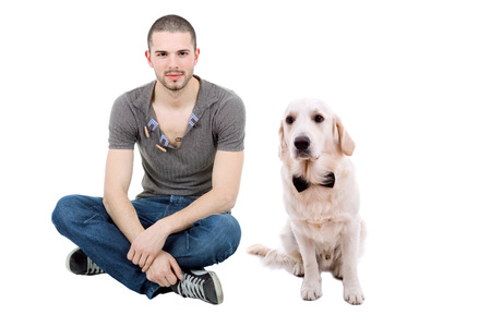 young casual happy man seated with a dog, on studio, isolated