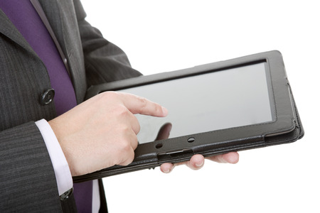 businessman using touch pad, close up shot on tablet pc, isolated photo