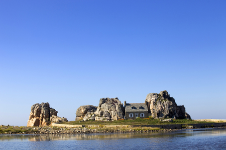 cote de granit rose: famous house on the rocks at ploumenach, cote de granit rose, cotes darmor brittany, france Editorial