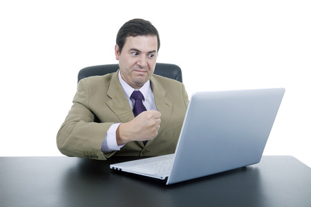 mad business man working with is laptop photo