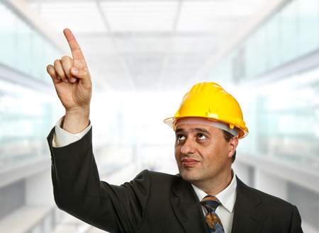 An engineer pointing up, at the office photo