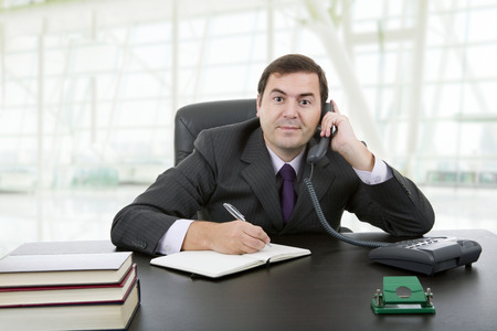 young business man writing on a desk Stock Photo - 27992514