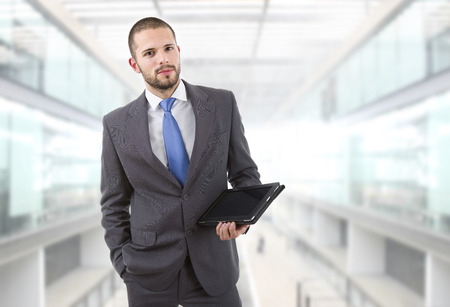 businessman standing: young businessman with a tablet pc at the office