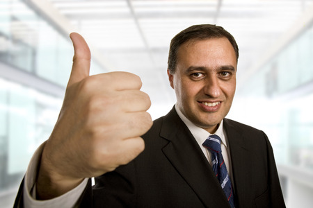 business man going thumb up, at the office photo