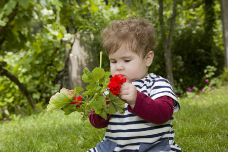 honey blonde: young baby girl at the garden Stock Photo