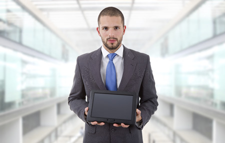businessman showing a tablet pc, at the office photo