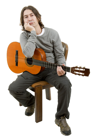 young musician: young musician with acoustic guitar, isolated