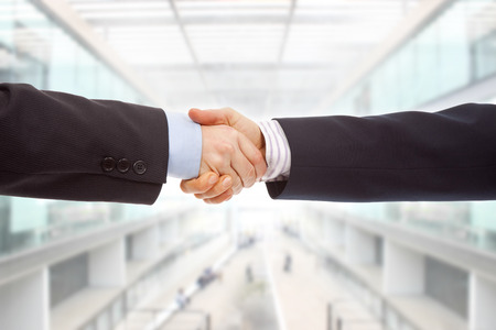 deal making: Business couple hand shake at the office