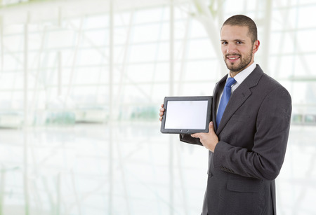 businessman using touch pad of tablet pc, at the office photo