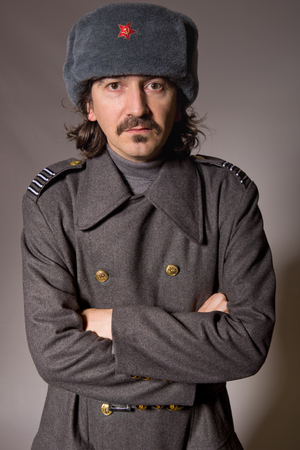russian man: young man dressed as russian military, studio picture