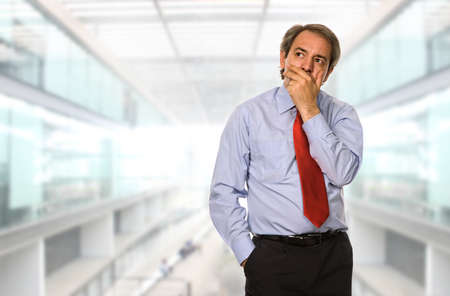 mature business man: mature business man thinking at the office