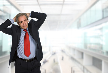 hardworker: worried businessman at the office Stock Photo