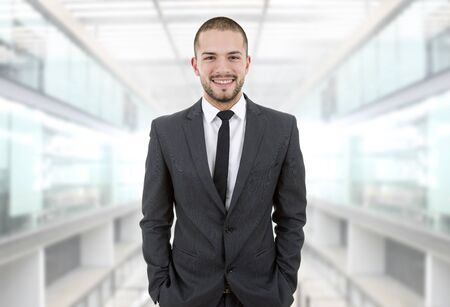 young: young business man portrait at the office