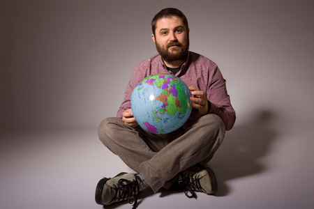 man full body: young casual man full body with a globe