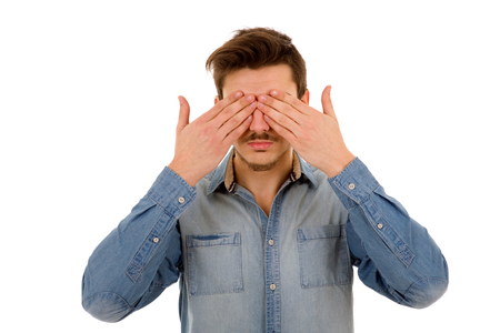 scruple: Man covering his face, isolated on white background Stock Photo