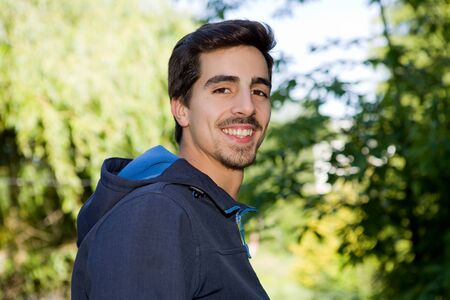 eyecontact: happy young casual man outdoor portrait Stock Photo