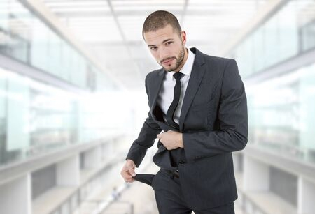 empty pocket: businessman showing his empty pocket, at the office Stock Photo